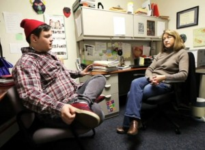Dalton Wooten meets with social worker Susan Hewitt. Screenshot courtesy of the Courier-Journal.