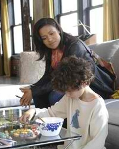Social worker Clea Hopkins (actress Gugu Mbatha-Raw) visits a mute Jake (actor David Mazouz) at his home. Photo courtesy of Fox.