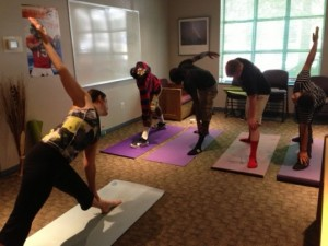 Social worker Elizabeth Auten leads a yoga session at Argus House, a group home for at-risk teenage boys in Arlington County. Photo courtesy of the Washington Post.