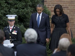 President Obama and First Lady Michelle Obama attend a memorial service for Navy Yard shooting victims. Photo courtesy of AP/USA Today.