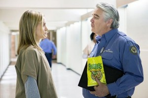Michael Harney portrays prison social worker Sam Healy and Taylor Schilling is inmate Piper Chapman in Orange is the New Black. Image courtesy of Netflix.