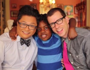 "From left: actor and comedian Alec Mapa, son Zion, and husband Jamison Herbert. Screen shot courtesy of  Alec Mapa's ""Baby Daddy"" Kickstarter website."