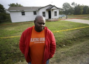 Terrence Walker stands in front of the house of his mother Mary Brownlow in Terrell, Texas. Walker's brother is accused of killing their mother, and aunt and three other people. Photo courtesy of Associated Press.