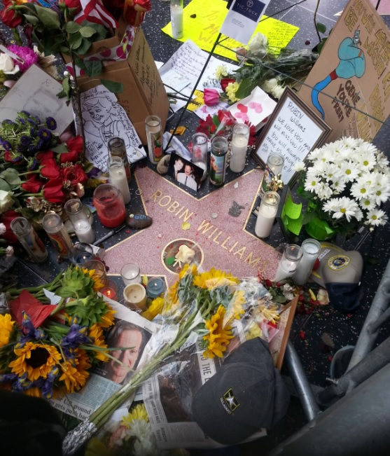 Fans leave flowers and mementos at Robin Williams' star at the Los Angeles Walk of Fame. Photo by Greg Wright, NASW.