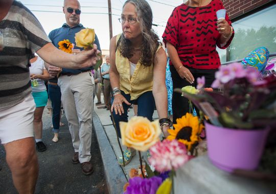 Mourners place flowers at a memorial for slain social worker Lara Sobel. Photo courtesy of Vermont Free Press.