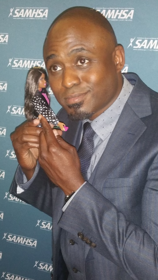 "Actor, comedian and Voice Award recipient Wayne Brady clowns around with ""Advocate Barbie,"" a doll used by SAMHSA Director of Consumer Affairs Keris Myrick to make it easier for people to talk about behavioral health and substance abuse."