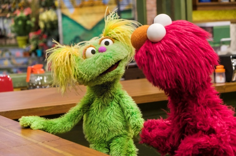 Karli (left) and Elmo. Photo courtesy of Sesame Street.